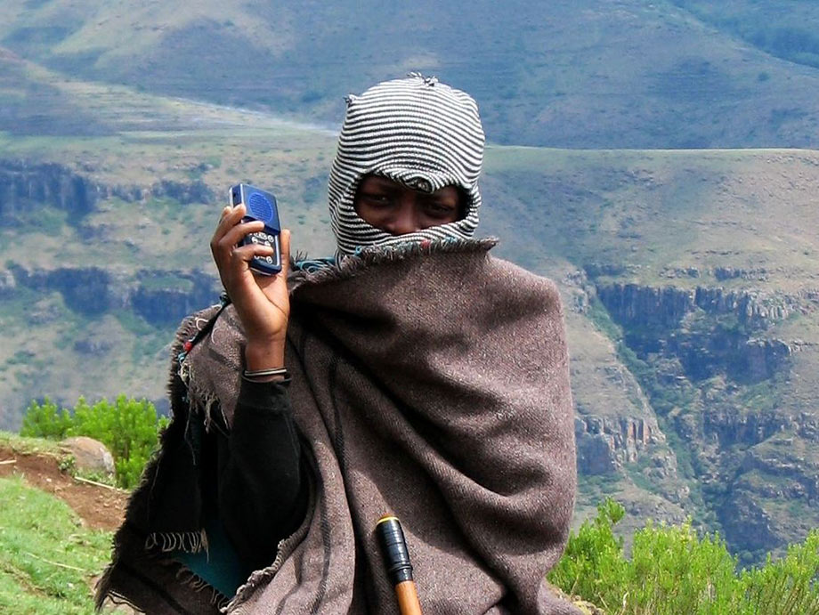 Lesotho Herder Listening to MegaVoice