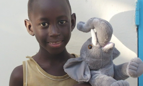 Boy with Elephant Wildlife STORYTELLER