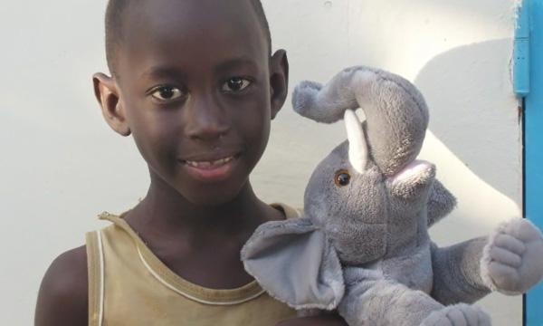 Boy with Elephant Wildlife STORYTELLER