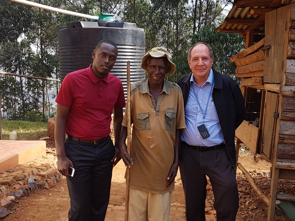 Gerald with Gerald's grandfather and Johan in Kabale Uganda