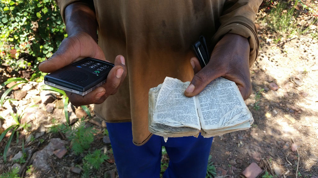 John with his Bible and MegaVoice Envoy S