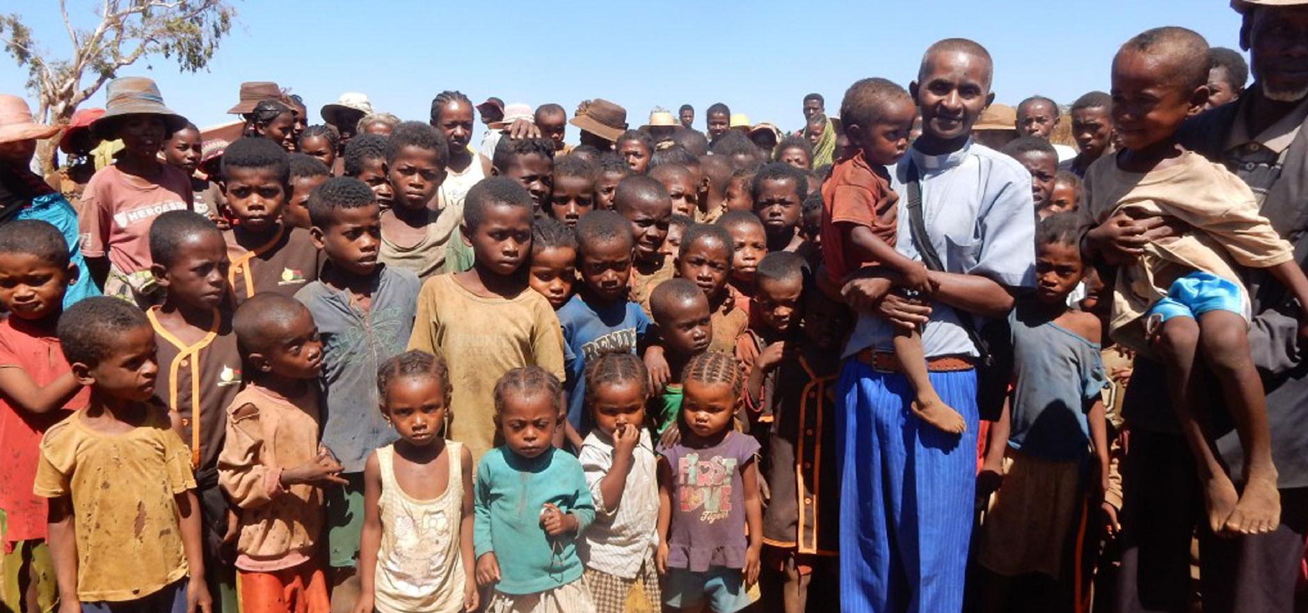 Children gathering to hear God's Word spoken in their language.