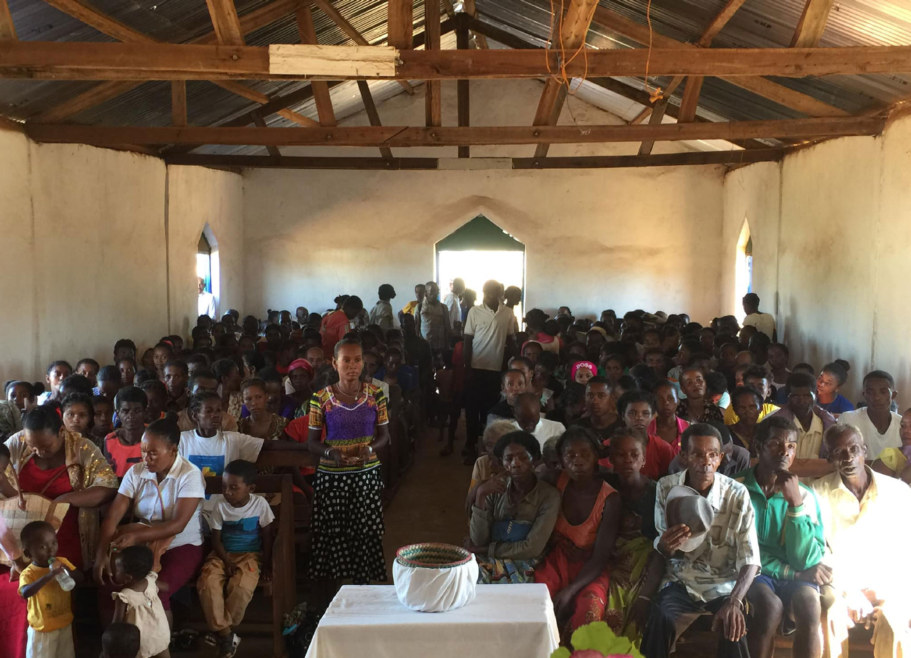 Church gathering to hear God's Word in their heart language